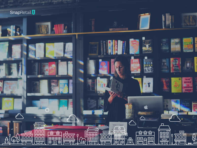 woman at cash register with books